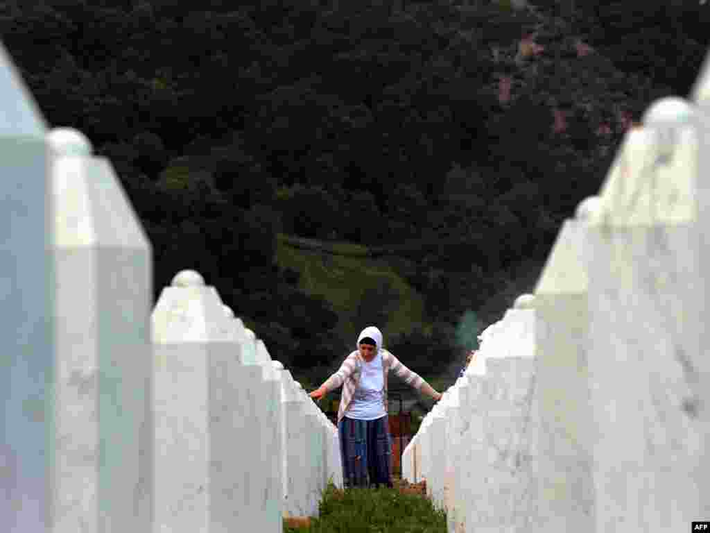 A Bosnian woman touches memorial stones at the Potocari memorial cemetery near Srebrenica on July 9. Bosnians on July 11 marked 15 years since the darkest episode of the bloody breakup of Yugoslavia, the Srebrenica massacre of nearly 8,000 Muslims by Serbs. Photo by Dimitar Dilkoff for AFP