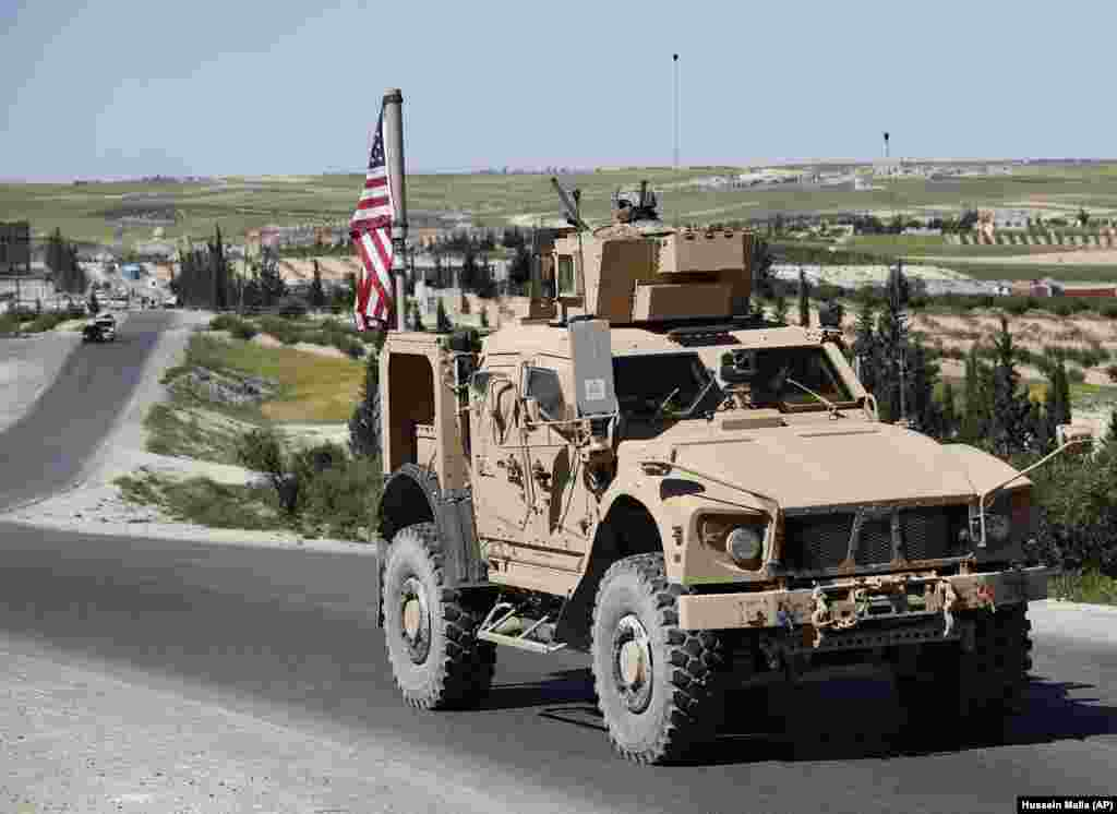 "A U.S. vehicle near Manbij in April 2018. On December 19, U.S. President Donald Trump declared it was time for American troops ""to come back home."" The statement led to a flurry of criticism that the move would embolden IS, with one Republican senator saying a withdrawal would be a mistake, claiming the Islamic State group has been ""degraded"" but not yet defeated."