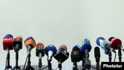 Armenia - TV and radio microphones set for a news conference in Yerevan.