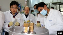 An International Atomic Energy Agency team checks the enrichment process inside the uranium enrichment plant at Natanz in January 2014.