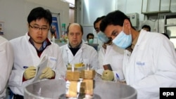 An IAEA team checks the enrichment process inside the uranium enrichment plant in Natanz, Iran, January 20, 2014