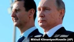 Башар Асад (сол жақта) және Владимир Путин. Сирия, Латакия. Желтоқсан, 2017 жыл