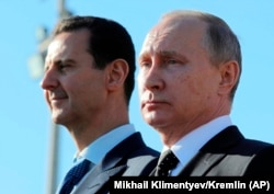 Russian President Vladimir Putin and Syrian President Bashar al-Assad in Syria on December 11.