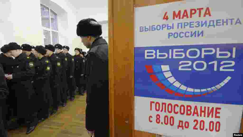 Sailors queue to vote at a polling station in the far eastern city of Vladivostok.