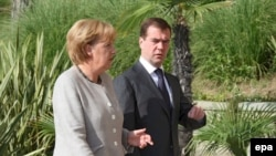 Medvedev and Merkel during a meeting in Sochi on August 15