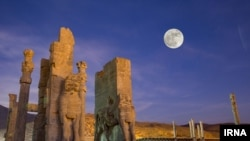 The 'Super' full moon rises above the Persepolis, situated 60 km northeast of the city of Shiraz in Fars Province.