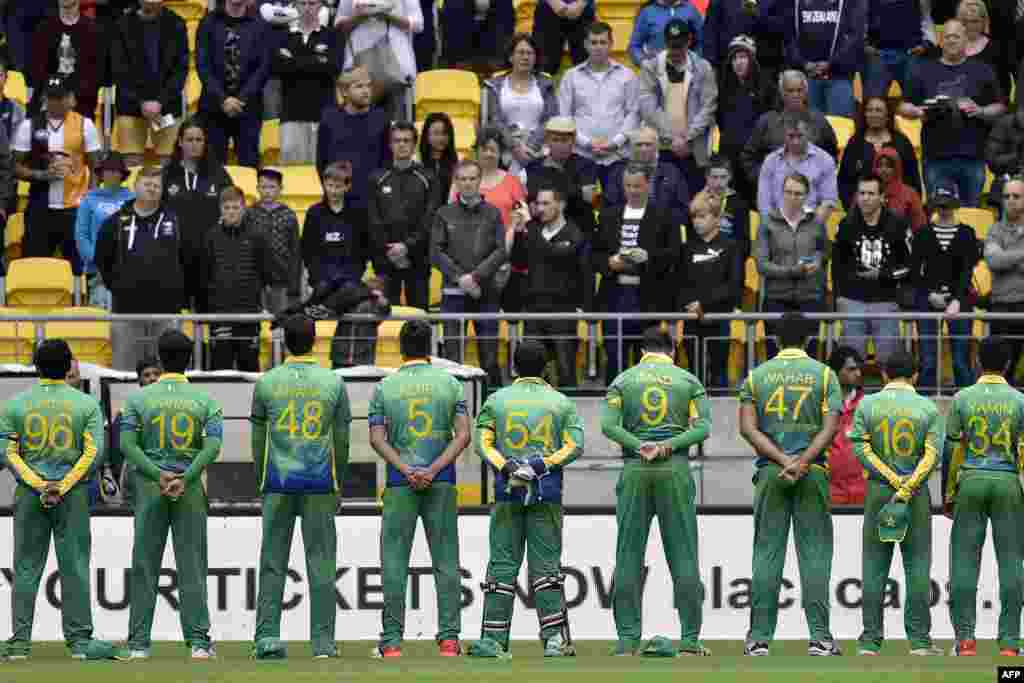 New Zealand -- Pakistan players stand for a moments silence for those killed in a terror attack in northwest Pakistan during the third T20 cricket match between New Zealand and Pakistan in Wellington at Westpac Stadium, January 22,2016