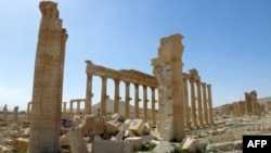 Разрушенная римская триумфальная арка в Пальмире, 27 марта 2016 года.