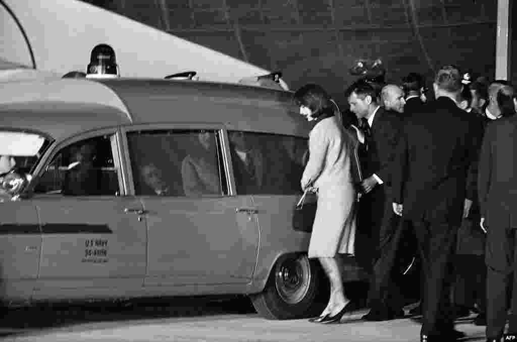 The slain president's body arrives at Andrews Air Force Base outside Washington and is attended to by his wife, Jacqueline Kennedy, and his brother, U.S. Attorney General Robert Kennedy.