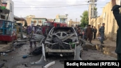 FILE: Aftermath of a bomb attack targetting the police in Kandahar.