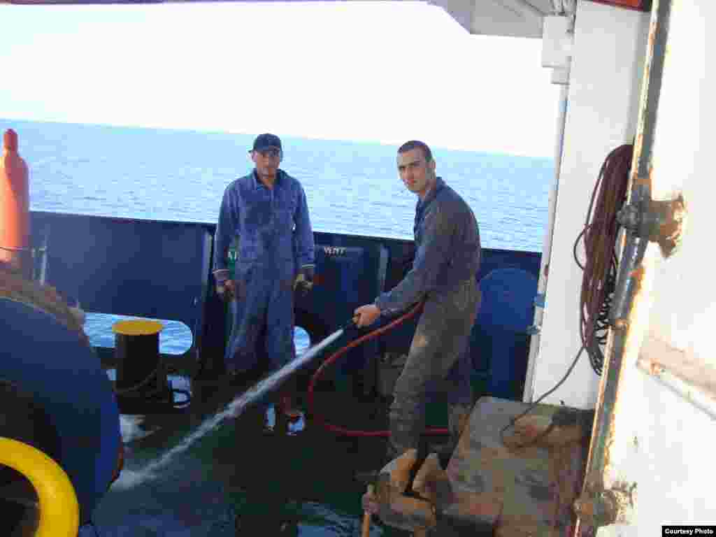 "Zurab Guralia, left, and Giorgi Kurashvili on board the ""Vasilios N."" - The ship originally set out with a 10-person crew -- six Georgians, three Ukrainians, and one Azerbaijani -- although one Georgian crew member was shipped home after falling ill from hepatitis. The common language on board was Russian. ""We're one crew, one family,"" one of the sailors said."