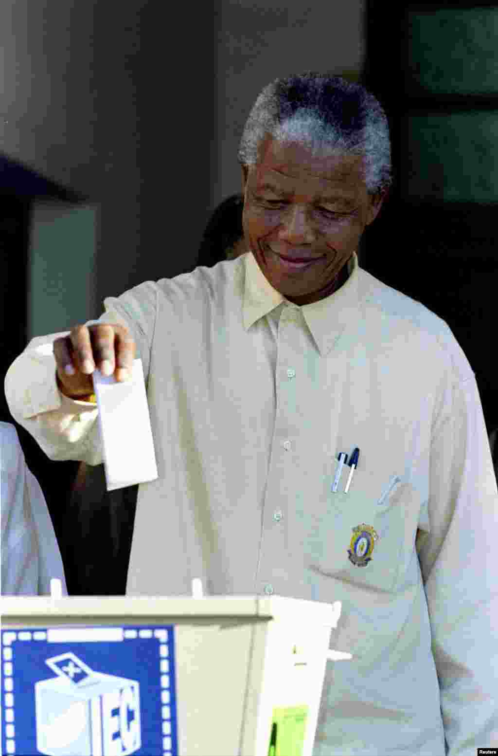 Nelson Mandela casts his ballot in South Africa's first multiracial elections in April 1994.