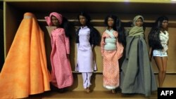 It seems these Barbie dolls wearing cultural clothes from around the world would not be welcome in Tajikistan, which is seeking to promote the country's traditional dress. (file photo)