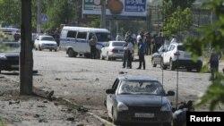 На месте взрыва бомбы в Дагестане. Махачкала, 20 декабря 2013 года.