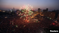 Fireworks explode as supporters of Muslim Brotherhood's presidential candidate Muhammad Morsi celebrate his victory in the election on Tahrir Square in Cairo on June 24
