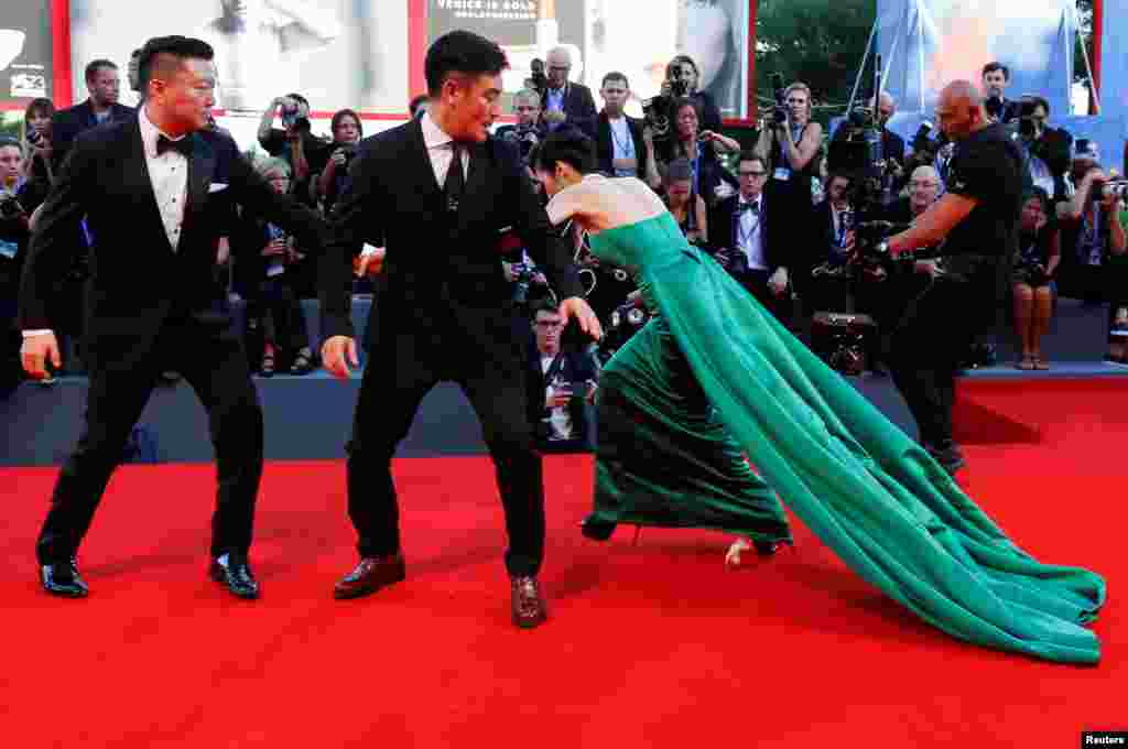 South Korean actress Moon So-ri trips during a red-carpet event for the movie The Light Between Oceans at the 73rd Venice Film Festival in Venice, Italy. (Reuters/Alessandro Bianchi)