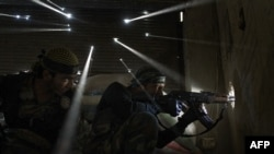 Syria -- Two rebels take sniper positions at the heavily contested neighborhood of Karmal Jabl in central Aleppo, 18Oct2012