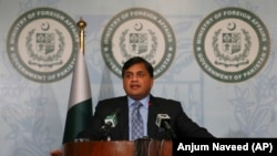 PAKISTAN -- Pakistan's foreign ministry spokesman, Mohammad Faisal briefs journalists regarding a migrant boat drowned incident, in Islamabad, February 4, 2018