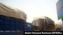 Heavily laden trucks line the highway outside the Afghan capital, Kabul.