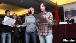 Armenia - Young civic activists denounce the findings of Western election observers during the latter's news conference in Yerevan, 19Feb2013.