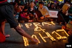 Акция памяти жертв катастрофы MH-17 в Малайзии