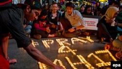 Памятная церемония по погибшим пассажирам рейса MH17 Malaysian Airlines. Малайзия, июль 2014 года.