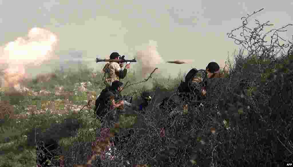 A video grab shows a Syrian opposition fighter firing a rocket-propelled grenade during clashes with regime forces over the strategic area of Khanasser. (AFP/Salah Al-Ashkar)