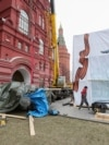 The scene on Moscow's Manezhnaya Square on March 20 after a monument to Soviet World War II Marshal Georgy Zhukov (on ground at left) was taken down overnight and replaced with a slightly altered version of the same statue.