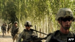 U.S. troops patrol during a mission in Logar Province, Afghanistan on August 14.