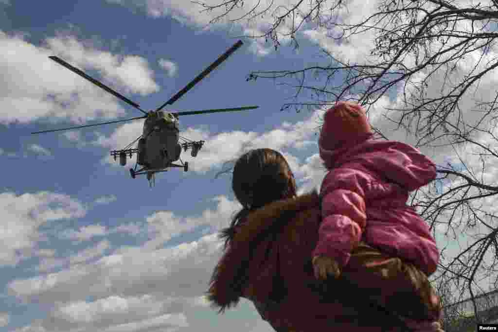 A Ukrainian MI-8 military helicopter is seen near the village of Salkovo in the Kherson region adjacent to Crimea on March 18. (Reuters/Valentyn Ogirenko)
