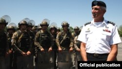 Armenia - The commander of the U.S. Army in Europe, Lieutenant General Mark Hertling (R), inspects Armenian peacekeeping troops in Yerevan, 18Jul2012.