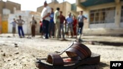A shoe lies on the ground near the site of a suicide bomb at a mosque in New Baghdad.