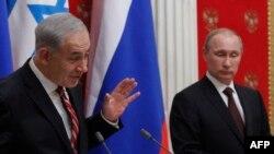 Премьер-министр Израиля Биньямин Нетаньяху (слева) и президент России Владимир Путин.
