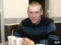 Aleksandr Glukhov speaks to the press at a McDonald's in Tbilisi in January