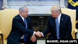 US President Donald Trump shakes hands with Israel's Prime Minister Benjamin Netanyahu in the Oval Office of the White House on March 5, 2018 in Washington, DC.