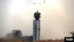 A Russian surface-to-air S-300 missile system is fired during a military drill late last year.