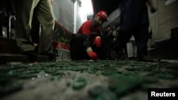 A worker collects evidence at the site of a deadly bomb blast in Peshawar, Pakistan on February 4.