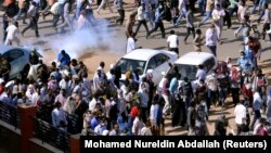 Sudanese demonstrators gather in Khartoum for antigovernment protests last month.