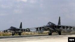 Російські військові літаки Су-25 на базі у Сирії поблизу Латакії. 6 жовтня 2015 року