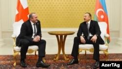 Presidents Giorgi Margvelashvili of Georgia (left) and Ilham Aliyev of Azerbaijan have a one-on-one meeting in Baku on February 12.