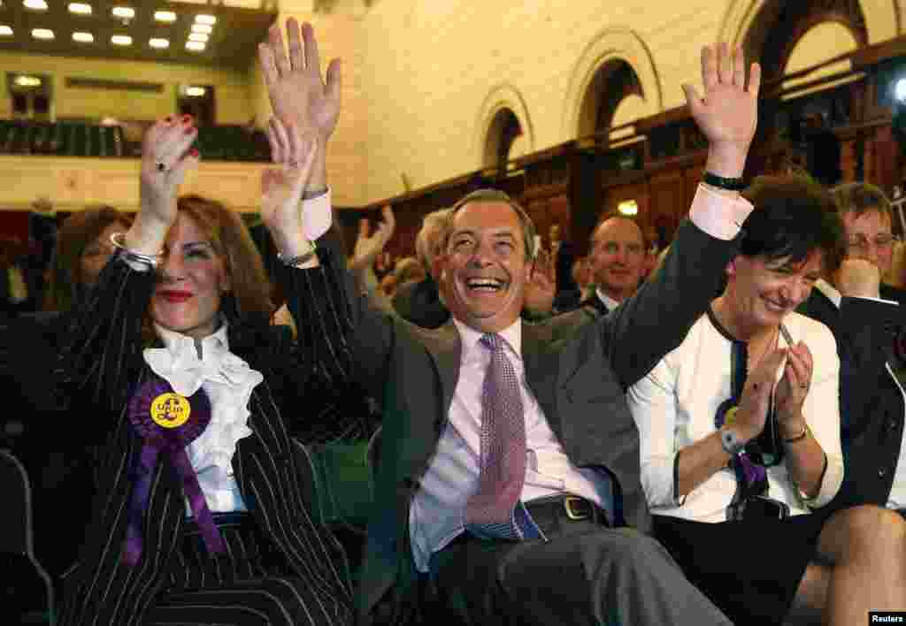 Nigel Farage (center), the leader of the right-wing United Kingdom Independence Party (UKIP), celebrates with his party's candidates after winning some 28 percent of the vote in Great Britain.