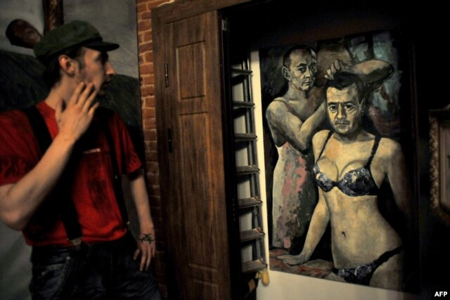 A visitor looks at Konstantin Altunin's controversial painting of Russian President Vladimir Putin and Prime Minister Dmitry Medvedev in the Museum of Authorities in St. Petersburg.