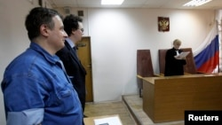 Aleksandr Cherkasov (L), head of Russian human rights group Memorial, attending a court hearing in Moscow last year.