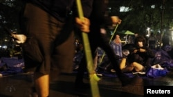 Occupy Wall Street protesters clean Zuccotti Park ahead of an eviction notice issued by New York City authorities.