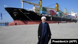 FILE: Iranian President Hassan Rohani posing in Chabahar port.