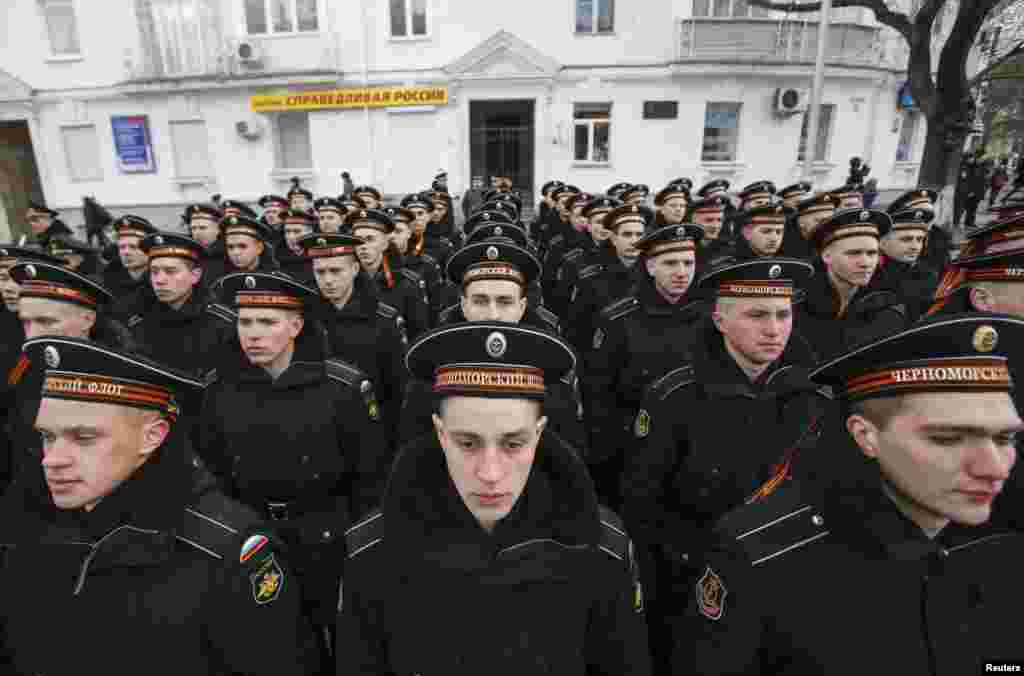 Russian Navy sailors line up as they take part in a festive ceremony marking the first anniversary of the signing of a treaty annexing Crimea, in Sevastopol on March 18. (Reuters/​Maxim Shemetov)