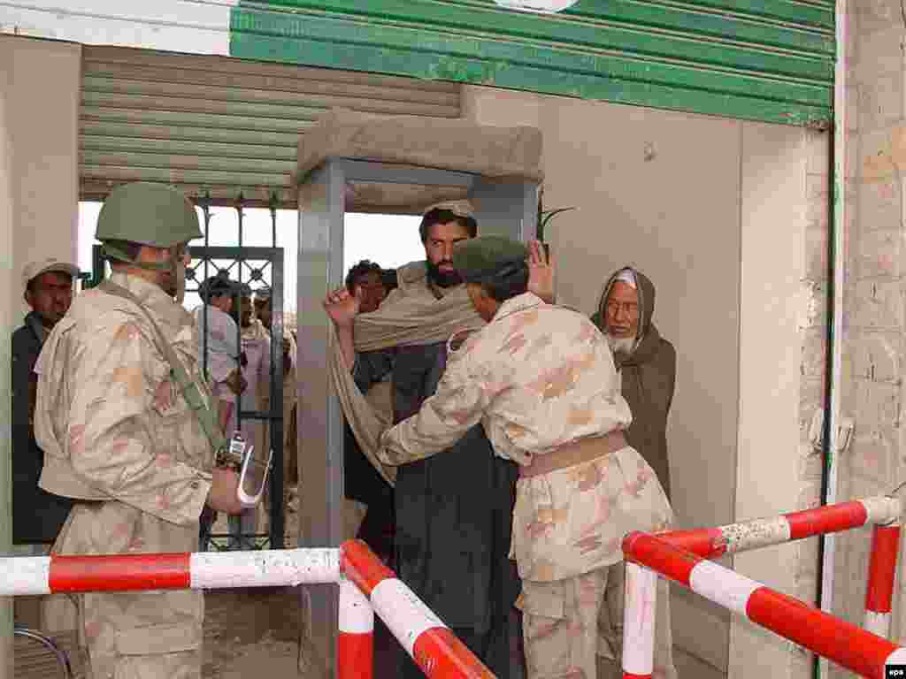 A Pakistani paramilitary troop frisks a Pashtun tribesman as he crosses the border - But in fact, mutual relations have been strained from the start, when Afghanistan voted against nascent Pakistan's United Nations membership over Kabul's refusal to recognize the so-called Durand Line, which demarcated British colonial India. No Afghan government has ever recognized the legitimacy of that 19th-century border.