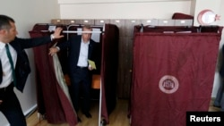 Turkey -- Turkish President Tayyip Erdogan leaves a polling booth at a polling station during the parliamentary election in Istanbul, June 7, 2015