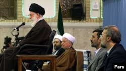 Is Supreme Leader Ayatollah Ali Khamenei's (left) position threatened by the factional battles of President Mahmud Ahmadinejad (second from right) and parliament speaker Ali Larijani (right)?