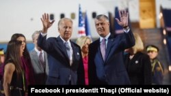 Standing alongside Kosovar President Hashim Thaci (right), U.S. Vice President Joe Biden (left) waves to onlookers upon his arrival in Pristina late on August 16